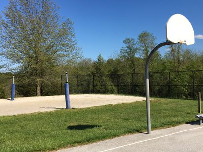 The basketball rims and beach volleyball net were removed at Centennial Park in Ellicott City to prevent people from crowding the park and possibly spreading COVID-19.