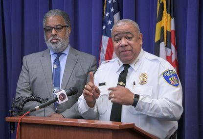 Baltimore Police Commissioner Michael Harrison (right) announces support for a pilot program to use three private surveillance planes over the city to combat crime. He was joined by city solicitor Andre Davis.