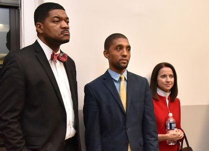 Candidates for mayor of Baltimore T.J. Smith, Brandon Scott and Mary Miller wait to speak at a forum in February 2020.