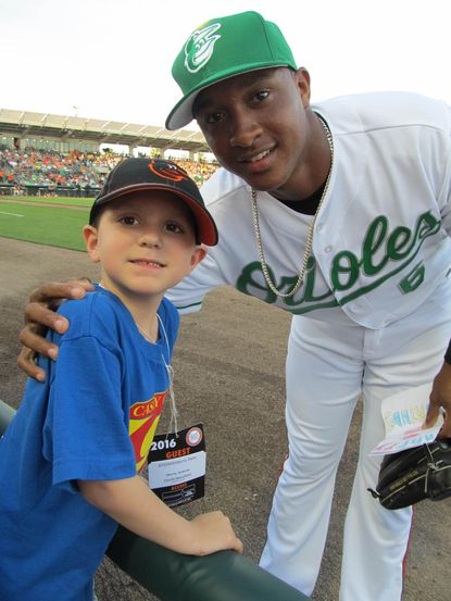 Orioles second baseman Jonathan Schoop with 5-year-old Andrew Oberle, who is battling leukemia and was at spring training last week through Casey Cares.