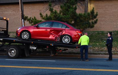One of the vehicles damaged in the incident at Rossville Blvd. and Kelso Dr. involving multiple vehicles is loaded up onto a tow truck. November 20, 2019