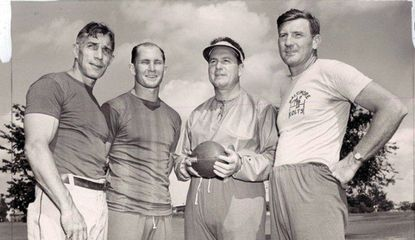 From left, Colts assistant A.M. Michalske, quarterback Y.A. Tittle, head coach Cecil Isbell and assistant Bill Conkright pose for a picture at training camp in Westminster on Aug. 16, 1949.