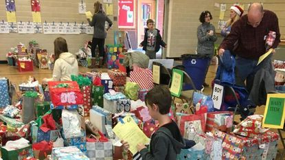 St. Margaret Church volunteers sort and prepare gifts for the 340 local families they will help this year with their annual Christmas Giving Program.