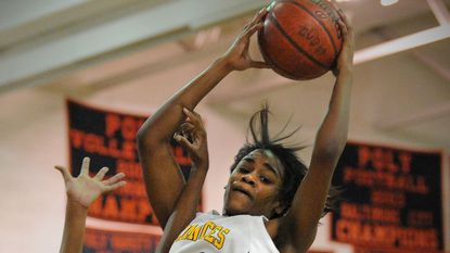 """St. Frances guard Briana """"Breezi"""" Hutchen pulls in a rebound in December 2008. She and fellow former Panther Shatyra Hawkes started the U.S.E. Basketball Family Reunion to give back to the younger girls who play basketball in the Baltimore area."""