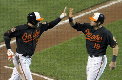 Orioles Nick Johnson is congratulated after his 2-run homer by teammate Chris Davis in the 7th inning.