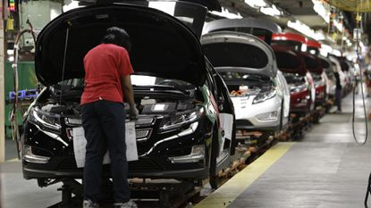 A worker assembles a Chevrolet Volt at a plant in Hamtramck, Mich., in 2011. GM is laying off thousands of workers and may close five plants, including the Detroit/Hamtramck plant that makes the Buick LaCrosse, Chevrolet Impala and Volt, and Cadillac CT6.