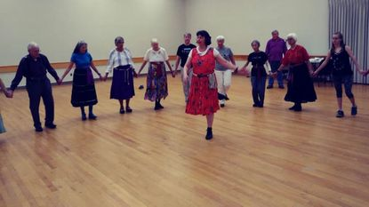 Nancy Jo Lame leads the Aug. 30 session of the Columbia International Folk Dancers, in Kahler Hall.