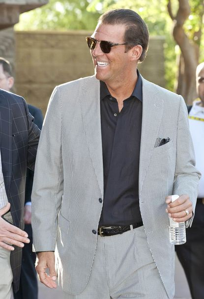 Ravens owner Steve Bisciotti arrives for the 2013 NFL meetings in Phoenix.