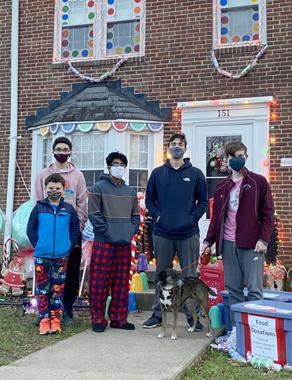 Back row, from left: Howard Denney III, a sophomore at the Boys' Latin School, and friends Sid Subramanian, Adam Decker and Gabe Foster, along with Sam Denney, front row, are taking part in the Denney family's Santa's Elves Food and Toiletry Drive.