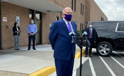 Gov. Larry Hogan takes questions from the media outside of the Berry plastic plant in Baltimore about early voting, COVID-19 and his recent joke about running for Baltimore mayor.