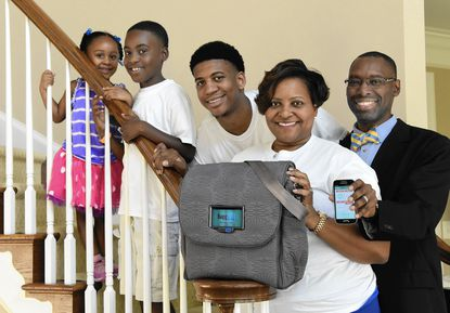 The Myers family, left to right: Cori Myers, 3, Jaden Myers, 8, Deondre' Robinson, 18, Tonika Myers and Cory Myers. Tonika and Cory Myers are a husband and wife team who are the inventors of Baggio, a smart diaper bag that can alert caretakers via smartphone when the diaper bag is running low on supplies.