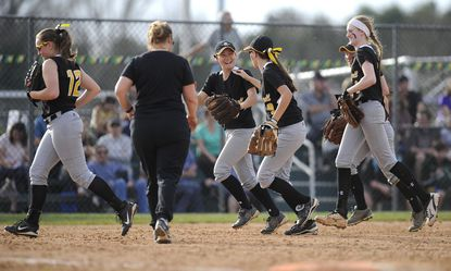 South Carroll's Sydni Carroll, center, is congratulated after making a catch to close the sixth inning of their game in Eldersburg Monday, April 10, 2017.