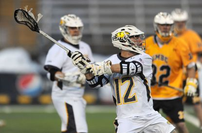 Towson University's Ben McCarty winds up to shoot and score against UMBC.