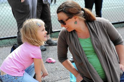 Amy Favinger, Ellicott City, a stay-at-home mom, shares a smile with her daughter, Andrea, 5.