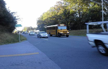 Early morning traffic negotiates the intersection of Route 152 and Connolly Road in Fallston, where accidents occur frequently.