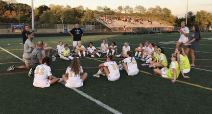 Mt. Hebron's girls soccer team meets during halftime of its 4-2 win over Howard on Thursday, Sept. 26, 2019.