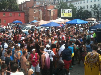 The tailgating party in the parking lot behind Eddie's in Mount Vernon during Baltimore Pride in 2013 was packed.