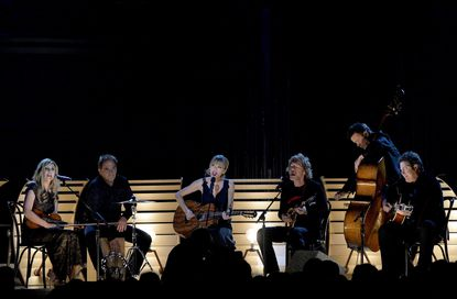 From left, Alison Krauss, Eric Darken, Taylor Swift, Sam Bush, Edgar Meyer and Vince Gill perform during the 47th annual CMA Awards.