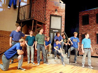 """The Jets of """"West Side Story"""" stare down their opposing gang. From left: sophomore Jordan Spencer; junior Brandon Harris; freshman Jeremy Lewin; senior Christian Zeitler, playing A-Rab; sophomore Shane Owings; freshman Wil Clancy, portraying Baby John; senior Troy Vratarich, playing Diesel; sophomore Jake Wills, portraying Snowboy; sophomore Jacob Fischer; and senior Alex Dangel, portraying Action."""