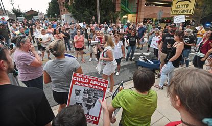 Protesters continue to gather outside after Harford County Board of Education closed a public meeting on August 16, 2021. Over 100 people gathered to protest the mask mandate for everyone inside school buildings when in-person classes resume in the fall. (Kenneth K. Lam/Baltimore Sun).