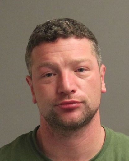 Thomas Cregon man was arrested Saturday night after he allegedly fired shots into the ground during a dispute with a neighbor and then barricaded himself in his home.