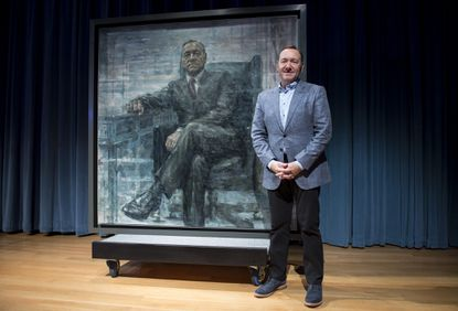"Kevin Spacey poses for a photo with a portrait of President Frank Underwood (from the Netflix series ""House Of Cards"") at a press conference hosted by The Smithsonian and Netflix at the National Portrait Gallery on February 22, 2016 in Washington, DC."