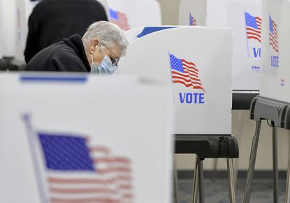 In this Monday, Oct. 26, 2020, file photo, voters fill out their ballots at the Washington County Election Center in Hagerstown. Those who applied for a mail-in ballot and then dropped it off or mailed it back avoided the long lines that plagued some polling spots. (Colleen McGrath/The Herald-Mail via AP, File)