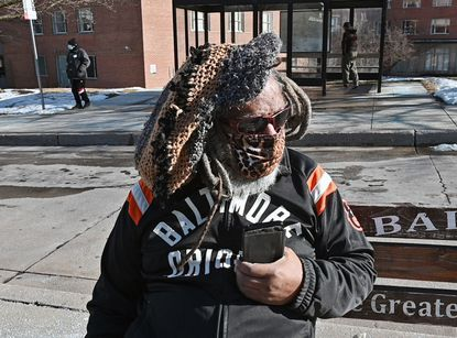 Harold Dobson, 68, waiting for a bus near SInai Hospital, had not gotten the COVID-19 vaccine as of Feb. 24. (Kenneth K. Lam/Baltimore Sun).