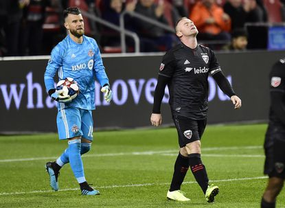 D.C. United forward Wayne Rooney (9) walks away from the net after Toronto FC goalkeeper Quentin Westberg (16) made a save during second half of an MLS soccer Eastern Conference first-round playoff match in Toronto on Saturday, Oct. 19, 2019.
