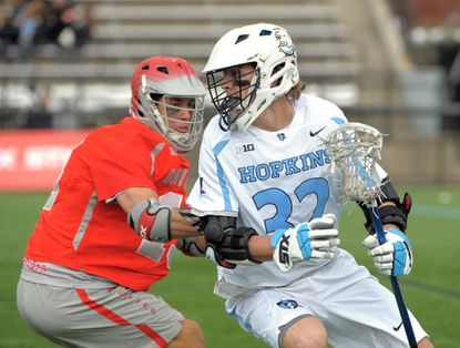 Ohio Stateplayer Bo Lori #13, left, tries to get the ball from Hopkins player Shack Stanwick #32 in the 2nd quarter. Johns Hopkins Blue Jays play Ohio State in lacrosse at Homewood Field.
