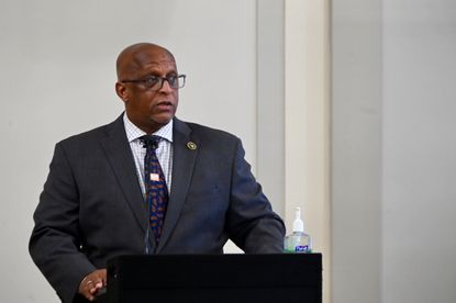 Baltimore Mayor Jack Young, shown here at a press conference in June, announced restrictions Wednesday to slow the spread of coronavirus in the city, including the suspension of indoor dining, after COVID-19 cases began climbing.