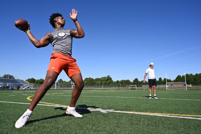 Reservoir senior Malcolm Brown works on his quarterback skills with teammates at the school on Wednesday, July 29.
