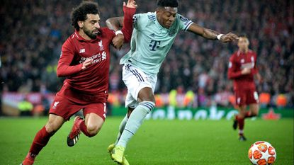 Liverpool's Mohamed Salah and Bayern Munich's David Alaba vie for the ball during a Champions League game Feb. 19.