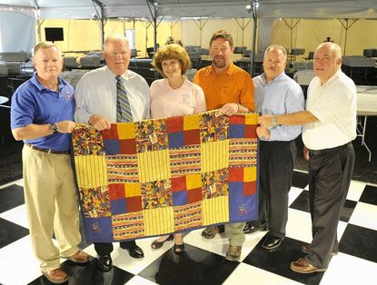Left to right: Jim Costigan, Ed Carnes, Kit Roache, Kevin O'Brien, Scott Cheseldine and Bob Fasulo have all worked to make the Support Our Heroes Ball happen. They are holding a handmade quilt that was to be auctioned off at the ball.