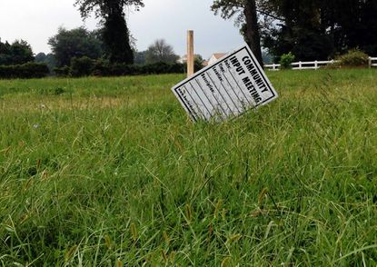 A community input meeting scheduled for Wednesday evening is advertised on this sign, placed on a grassy lot along Conowingo Road in Dublin, where developers plan to build a Dollar General retail store.