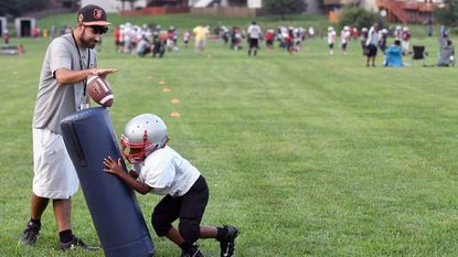 Youth, varsity football programs ease concerns over head injury potential