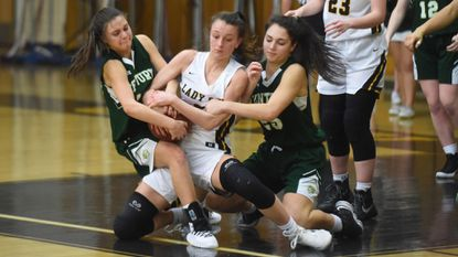 South Carroll's Lauren Habighorst, center, fights for a loose ball while double-teamed by Century teammates Madison Plitt, left, and Demma Hall during a girls basketball game at South Carroll High School on Jan. 2, 2019.