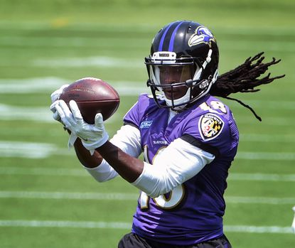 Ravens wide receiver Breshad Perriman makes a catch during OTA at the Under Armour Performance Center in May.