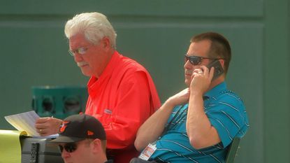 Longtime Orioles scout Bruce Kison (left), and vice president of baseball operations Dan Duquette watch the club's first intrasquad game at Ed Smith Stadium in 2017.