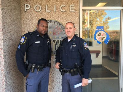 Officer Max Mills, right, with Sgt. Sundia Gaynor, at the Wilkens precinct of Baltimore County Police. Mills was praised last month for going out of his way to help a homeless man in Catonsville find shelter.