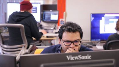 Automation engineer Mahfuz Alam works at the office of Zebit, a San Diego tech company building a marketplace for those living paycheck to paycheck.