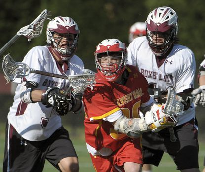 Boys' Latin's Casey Rees, left, and Nick Shepherd, right, chase Calvert Hall's Timmy Kelly early in the second half.
