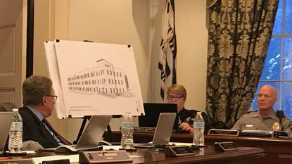 Attendees of the Westminster Common Council meeting on May 13 view a rendering of a planned affordable housing apartment building in Westminster.