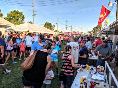 Folks at the Reese fire carnival crowd the food booths in search of fair food on July 15, 2019. Last year the carnival featured more than 20 rides, food, and games and was crowded from July 15-20, 2019. On July 9, 2020, the fire company announced that the original date – and make-up date for the carnival this year was cancelled as a result of the COVID-19 pandemic.