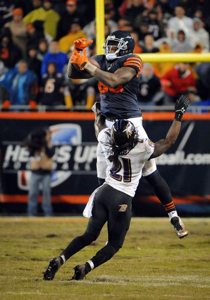 Chicago Bears tight end Martellus Bennett, top, catches a pass over top of Ravens cornerback Lardarius Webb in overtime.