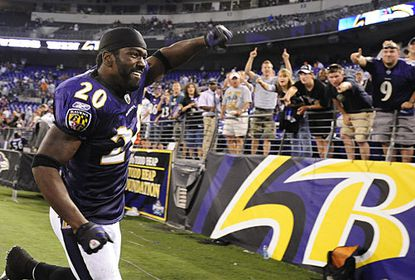 Safety Ed Reed, who returned an interception 32 yards for a touchdown in the third quarter, celebrates with fans after the Ravens' 28-10 win over the Cleveland Browns at M&T Bank Stadium.