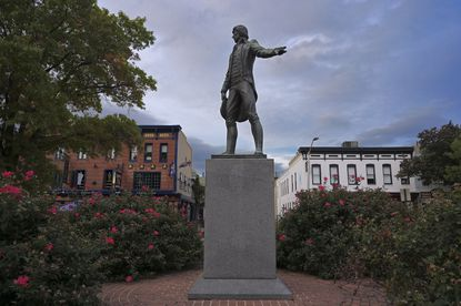 Surrounded by iron fencing, a statue of Capt. John O'Donnell (1749-1805) stands in the middle of O'Donnell Square, nestled in the center of the commercial district of Canton Sat., Oct. 24, 2020. (Karl Merton Ferron/Baltimore Sun Staff)