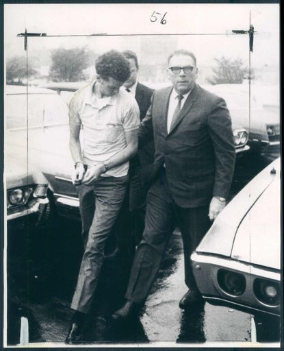 Wayne Stephen Young, charged in the slaying of Esther Lebowitz, is taken into Baltimore police headquarters by homicide detective Sgt. Harry Bannon in this 1969 photo. Young, who has been behind bars since then, was recently granted a new trial in the case.