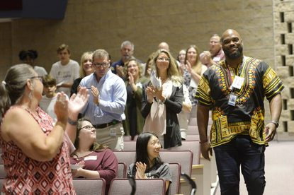 Winters Mill principal Michael Brown walks to the stage to be recognized during Carroll County Public Schools' 2019 Culture Expo at Winters Mill High School in Westminster Wednesday, Aug. 21. Brown recently recently spoke to some 100 students at the Minority Student Summit.