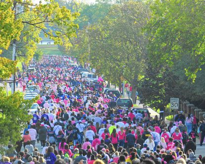 Thousands walk towards Lake Montebello during the Making Strides Against Breast Cancer event.